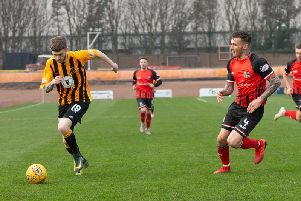 Calum Adamson, left, in action against Elgin City at Shielfield Park, coming up against Daryl McHardy, right.