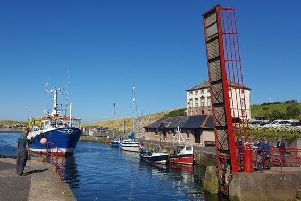 Eyemouth's red bridge opened to let a boat through to the boat yard.