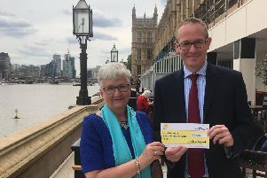 Borders MP John Lamont presents the cheque to  Maureen Stevenson, South of Scotland fundraising manager for Marie Curie Scotland
