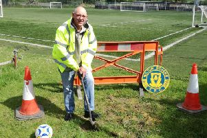 Milton Rovers chairman works on digging foundations for new floodlights (Submitted pic)
