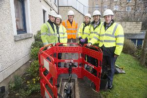 Checking out new full-fibre equipment are (left to right) Grant Forsyth, trainee engineer Toni Aprile, MSP John Lamont, and Openreach's Stewart Williamson, Brendan Dick and Steve Wood.