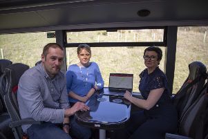 Graham McQueen, Shona Haslam and Sharon Morrison check out the new Borders Buses website.