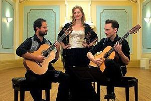 Flautist and mezzo-soprano Emily Andrews and classical guitarists Francisco Correa and David Massey