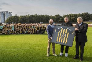 Berwick Juniors receive their new kit with Richard Simpson (Simpsons Malt vice-chairman), Sean Jackson (Berwick Juniors secretary) and David McCreath (Simpsons Malt director). Photo by Phil Wilkinson