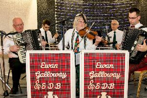 The Ewan Galloway Scottish Dance Band, led by Ewan (pictured on the right hand side playing accordion)