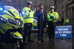 Launching this year's festive campaign, the first since the introduction of new drug-driving laws, are, from left, Chief Inspector Darren Faulds, Justice Secretary Humza Yousaf, and Superintendent Louise Blakelock, Police Scotland's Deputy Head of Road Policing.