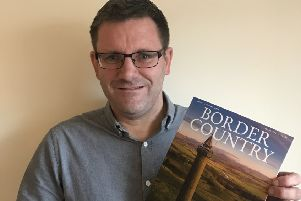 Phil Johnson with issue 1 of Border Country magazine