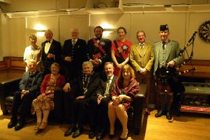 Duns Burns Club annual supper ' top table and guests ' back, from left: Candy Philip, Les Braby, Rob Cockburn, Ben Foreman, Fiona Carnie, David Philip and Andrew Ainslie; front: George Burchick, Rhona Burchick, Marshall Wilson, Graeme Small and Katherine Wilson.