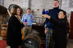 Motor Neurone Disease campaigner Doddie Weir with Glenkinchie Distillery manager Ramsay Borthwick, Diageo whisky specialist Louise Martin and apprentice whisky specialist Eve Murphy at the Glenkinchie Warehouse. (Photo: Mike Wilkinson)