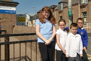 Members of the Boddam School Eco Group with one of the dog poo bag dispensers
