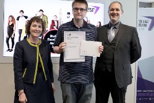 Justin receives his award from Rick Macleod and NESCol Principal Liz McIntyre.