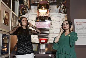 Alice Wyllie and Katie McAllister, from National Museums Scotland, listen in to the soundtrack of Scotland at the opening of Rip It Up (Photo Neil Hanna).