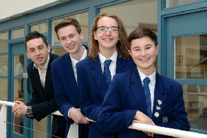 Entrepreneur Kieran Aitken is pictured with last year's winning team of Callum Sergeant, Colin Gass and Cameron Gunn from Dalziel High