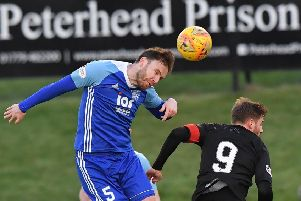 SCOTTISH LEAGUE TWO'PETERHEAD V CLYDE'(DUNCAN BROWN)''PETERHEAD'S MICK DUNLOP CLEARS FROM DAVID GOODWILLIE