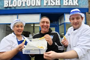 Peterhead FC manager Jim McInally at the Blootoon Fish Bar with owners Akie Bruce and son Marco Alexander