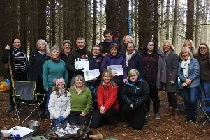 Health professionals, friends and family members celebrate with Branching Out clients, receiving their certificates and John Muir Discovery Award