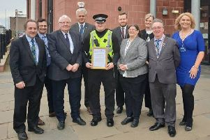 PC Mathew McKay accepts his Pride of Buchan Award from the Buchan Area Committee