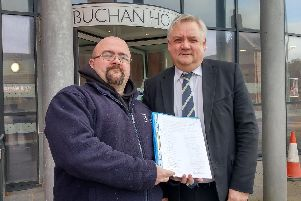 Local businessman Gilbert Burnett presented the petition calling for CCTV to Buchan Area Manager Chris White