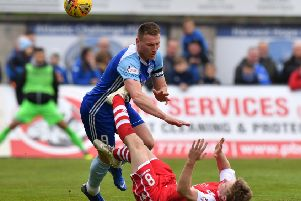 A sore one for Peterhead's Rory McAllister from Stirling's Dominc Docherty (pic by Duncan Brown)