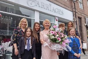The sisters' mum, Margaret, officially opened the new baby store on Wednesday afternoon and is pictured with her two girls and her grandchildren