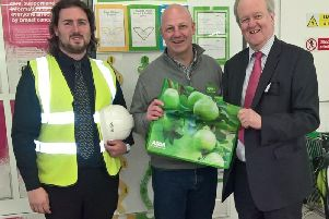 Site manager Ben Lord and store manager Edy Young with Stewart Stevenson MSP