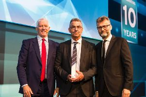 NHBC chief Steve Wood with winnerAlexander Taylorand comedian Hugh Dennis who compered the awards evening