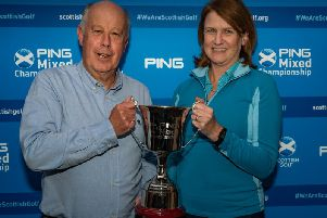 Alasdair and Gill with the winners trophy (Pic courtesy of Scottish Golf)