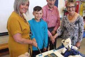 Designer of the Clerkhill School 50th birthday cake Aidan Davidson is pictured with current headteacher Ann-Louise Murray and former heads Gordon Brewster and Janet Adie
