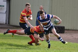 Howe winger Euan Muir evades two defenders to score Howe's first try. Pic by Chris Reekie.