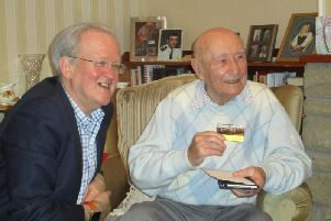 Banff and Buchan MSP Stewart Stevenson with Bob Ritchie, pictured holding his SNP Life Membership card.