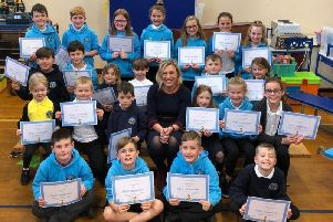 Gillian Martin with the Fetterangus School pupils and their certificates.
