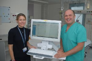 Consultant at ITU Iain MacLeod and Clinical Information Systems Manager for ICU, Lieneke van Beijma with one of the new systems