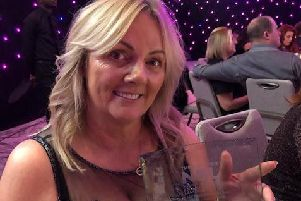 A delighted Ann pictured with her award.