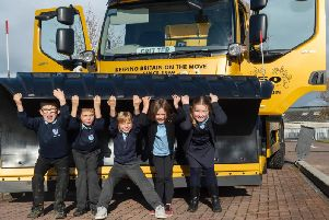 Youngsters with one of the gritters they named in a council competition.
