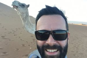 James MacKenzie pictured with one of the camels from his Saharan trek for charity.