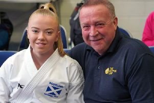 Carluke karate ace Emma Ruthven (pictured with her dad Drew) is accumulating medals at a formidable rate (Library pic).