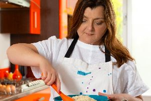 Sandra Donnelly whips up a new batch of cookies for her unique bakery.