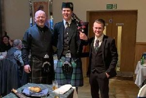 Pictured (left to right) are Ian Downie, Piper Robert Ironside, and Cameron Findlay of Shirley's Space at the fundraising Burns Supper.