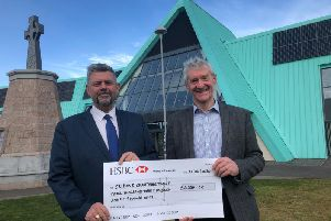 Peter Chapman hands over the cheque for 3,350 to Conrad Ritchie, chairman of the Crimond Charitable Trust.