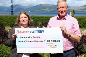 Alma Mickaill, from Bute Advice Centre, accepts the �20,000 cheque from Gordon Sutherland. The grant will be used to help vulnerable families on the island.