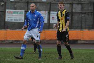 Dougie Brydon in action with Montrose's Leighton McIntosh back in 2013