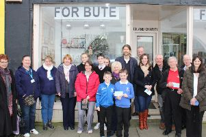 Pictured outside 'For Bute's Victoria Street shop are shop volunteers and representatives  of the organisations who have benefited from the popular thrift shop's latest round of awards.