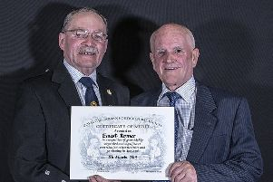 Lanark's green-fingered Ernie Romer (right) accepts the award from the Society's George Anderson.