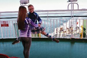 Harry Aiken, Highland Dancer with the Anne McIlroy School of Dance warming up whilst on his way to the Gourock Highland Games, on the ferry going from Rothesay to Wemyss Bay. Photo by Iain Cochrane.