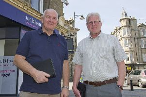 Councillors Watson McAteer and Stuart Marshall inspecting Hawick's CCTV system.
