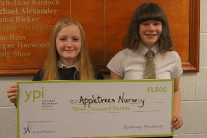 Rothesay Academy pupils Kiera Rutherford and Abbie Cameron with the prize for Apple Tree Nursery.