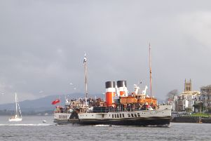 The paddle steamer Waverley sails into Rothesay Bay.
