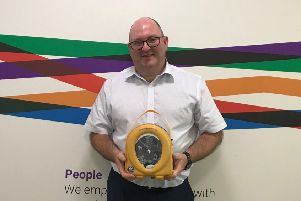 James Donaldson and Son integrated systems manager Mark Murphy with one of the automated external defibrillators.