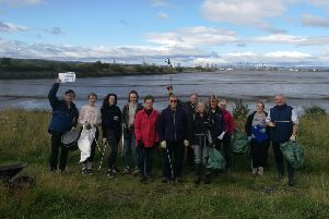 Angus MacDonald MSP (right) joined by local volunteers at Kinneil Local Nature Reserve for beach clean.