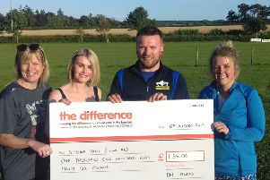 Handing over the cheque are, from left: Jennifer Elphick, Lorna Vass-Young, Dave McMillan and Becky Lambert.